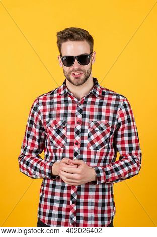 Well Groomed Hairstyle. Male Beauty And Fashion Look. Checkered Shirt For Bearded Guy. Unshaven Hand
