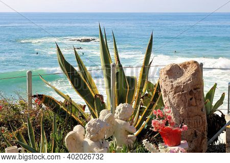 January 4, 2021 In Laguna Beach, Ca:  Angel Sculptures Besides Manicured Plants Overlooking The Paci
