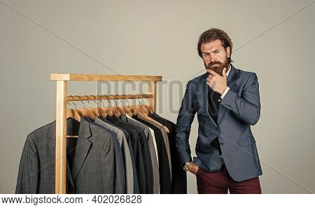 Man With Suit. Tailor In His Workshop. Handsome Bearded Fashion Man In Classical Costume Suit. Man I
