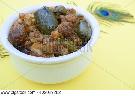 Indian Gujarati Special Dish Variety Undhiyu Or Undhiya Closeup With Yellow Background, Background D