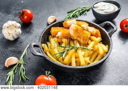 Fried Fish Sticks With French Fries. Fish Fingers. British Fish And Chips, Fried Potato. Black Backg