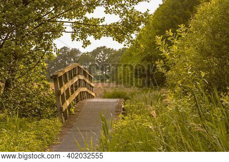 Wooden Bridge On Walking Track In Green Grassland River Valley Of Westerstroom Creek In Benneveld, D