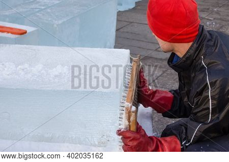 Closeup View, Faceless Image Of An Artist Making Ice Sculpture During Christmas Holidays Festival. I