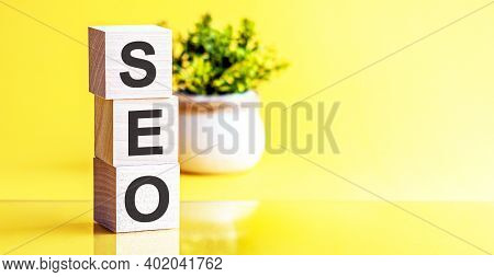 Motivational Words: Seo In 3d Wooden Alphabet Letters On A Bright Yellow Background With Copy Space,