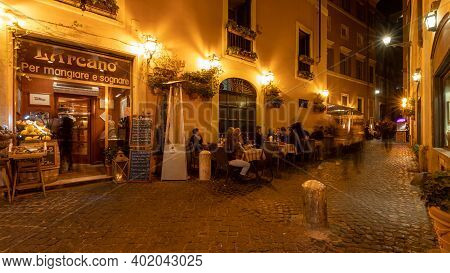 Via Delle Paste / Rome / Italy - July 03, 2019: Restaurants At Night With People Sitting On The Stre