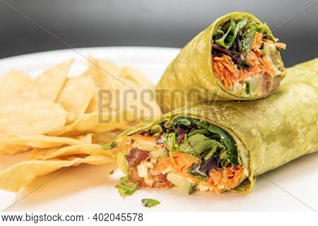 Vegetable Veggie Wrap Loaded With Layers Of Ingredients Of Healthy Food For This Meal.