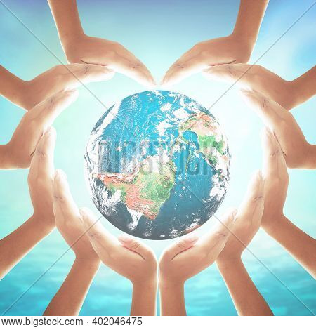 Corporate Social Responsibility (csr) Concept: Heart Shape Of Hands Holding Earth Globe Over Blurred