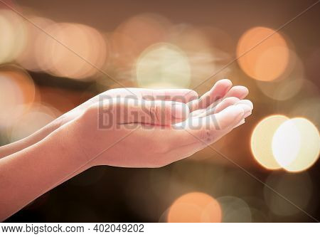 Children Hands Praying Over Abstract Blurred Spiritual Light Background
