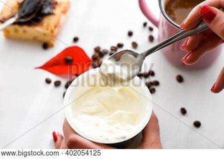 Top View On Girl Hands With A Bowl Of Yogurt. Young Woman Eating Organic Yogurt/ Healthy Yogurt For