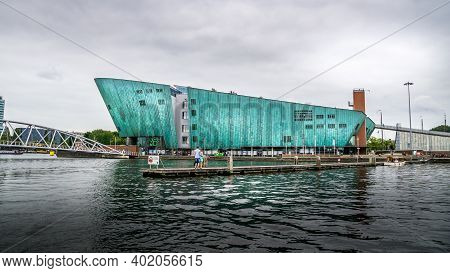 Amsterdam, Noord Holland, The Netherlands - Sept. 9 2016:  The Turquoise Colored Maritime Museum 'ne
