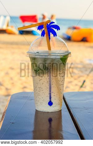 Fresh Mojito Cocktail On A Table On A Background Of Tropical Beach