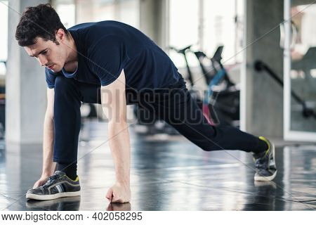 Handsome Man Exercise Workout In Gym Fitness Breaking Relax And Warm Up With Dumbbell For Bodybuildi