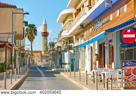 Limassol, Cyprus -  January 23, 2019: Street with minaret in its end in Limassol