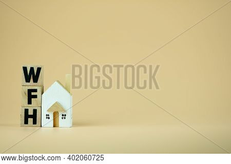 Wooden Blocks Word Of Wfh : Work From Home And Mini Home. Concept Of Work From Home During Corona Vi