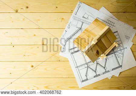Building House. House Construction. Many Drawings For Building And Wooden House On Wooden Background