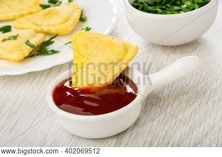 Savory Pies In Glass White Plate, Chopped Parsley In Bowl, Small Pie In Sauce Boat With Ketchup On W