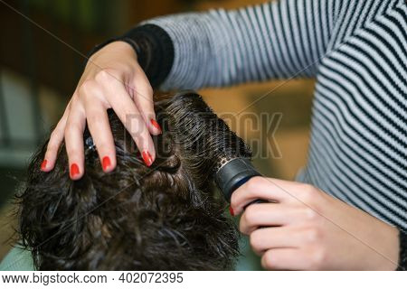 Hair Dresser Woman While Hair Drying Customer At Work, Home Beauty Treatment