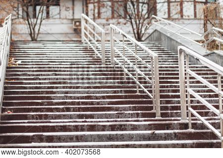 Icing Of The Sidewalk In The City On The Steps. Rain In Frosty Weather.