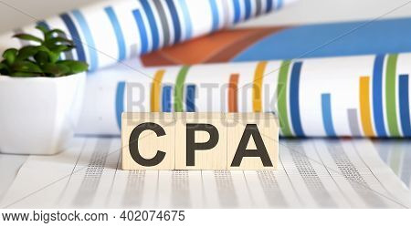 Cpa Certified Public Accountant Sign On Wooden Cubes With Chart