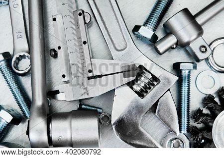 Metal Working Tools. Metal Style. Metal Tools On The Scratched Metal Background.