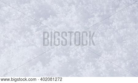 The Surface Of A Snowdrift Close-up. White Winter Natural Background Or Wallpaper. Snowflakes On A S