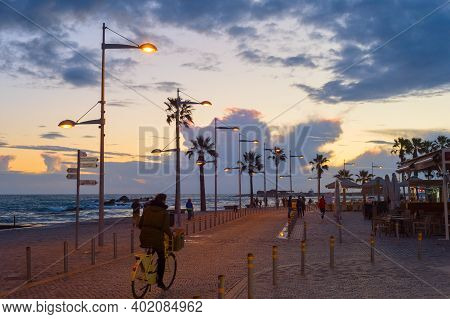 Paphos, Cyprus - February 15, 2019: People Walking By Embankment At Beautiful Twilight In Paphos
