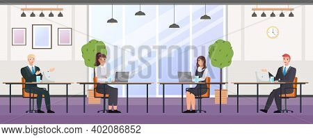 Business People In The Coworking Center. Man And Woman Sitting At A Table With Laptop Working Togeth