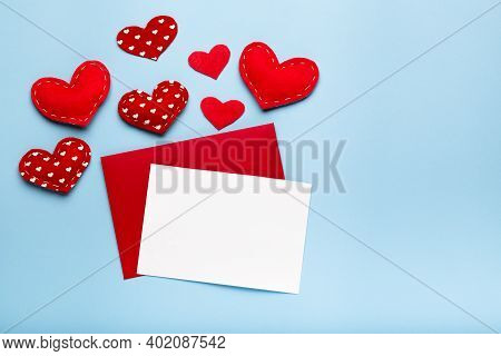 Valentines Day Love Letter Mockup. Red Envelope White Card And Hearts On Blue Background Copy Space
