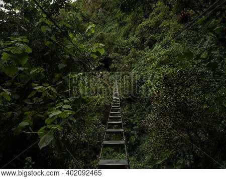 Steel Wire Rope Canopy Adventure Burma Bridge Over Green Rainforest At El Chorro De Giron Waterfall