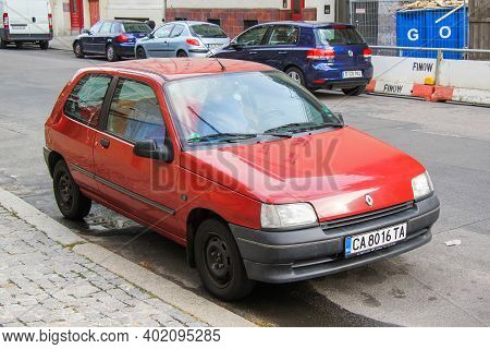 Berlin, Germany - September 12, 2013: Red Compact Car Renault Clio In The City Street.