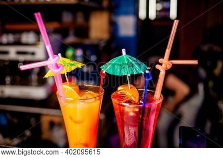 Fresh Tall Glass Of Tropical Cocktail With Juice At Bar Counter Background.cocktail Glasses With Ice