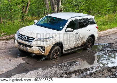 Moremi Game Reserve, Botswana - February 10, 2020: Dirty Offroad Vehicle Toyota Fortuner In A Slushy