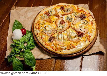 Pizza With Pear, Walnuts, Dorbl Cheese And Lemon Oil. Homemade Pizza With Pear, Walnuts And Gorgonzo