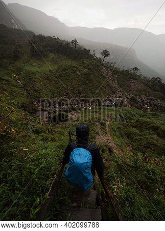 Young Hiker Descending Stairs At Catarata Del Gocta Waterfall In Bongara Amazonas Near Chachapoyas I