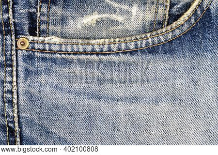 Dark Blue Jeans Fabric With Sude Pocket Background. Jeans Detail. Blue Jeans Texture Background.
