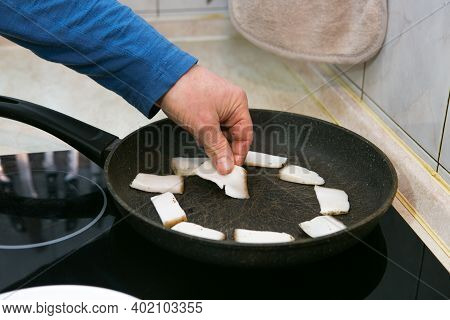 The Process Of Cooking Scrambled Eggs With Lard And Sausage. The Man Prepares Two Portions. A Man Sp