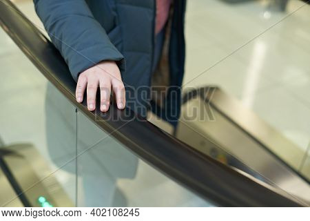 Female Hand On Escalator Handrail, Prevention And Virus Protection Concept In Mall