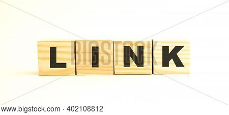 The Word Link. Wooden Cubes With Letters Isolated On White Background. Conceptual Image.