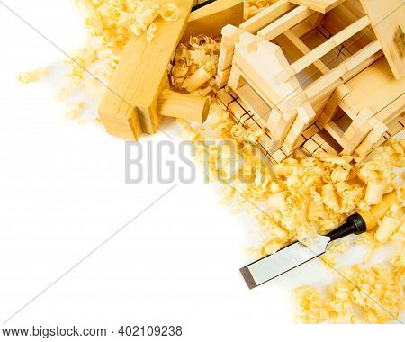 Woodworking. House Construction. Joiners Works. The Small Wooden House, Chisel, Plane And Shaving On