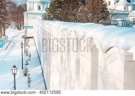 Wooden Fence Covered With Snow In Winter Cloudy Day After Snowfall. Winter Season, Cold Weather Conc