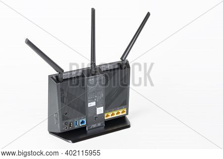 Brnenec, Czech Republic - January 31, 2020:rear View Of  Wi-fi Router Asus Rt-ac68u With  Three Ante