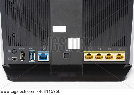 Rear View Of  Gigabit Dual-band Wi-fi Router.  Wireless Device With Five Gigabit Ethernet Ports, Ult