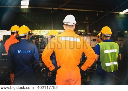 Rear View Group Of Industrial Technicians Wear Safety Work Clothes To Be Effective :  Meeting Was De