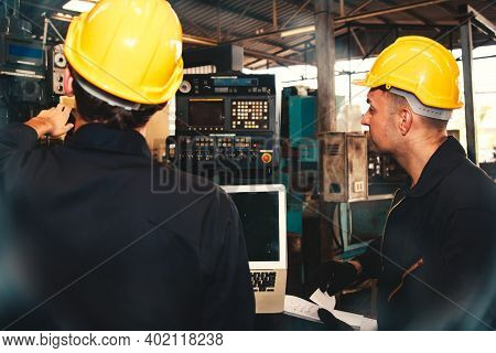 Team Of Male Electricians With Industrial Capabilities Perform Work To Inspect Damaged Control Panel