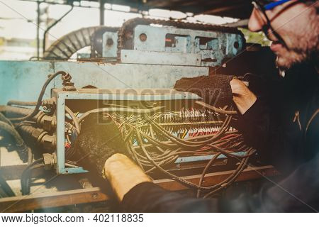 The Male Electrician In The Factory Has The Duty To Inspect The 3-phase Electrical Cable Box Of The