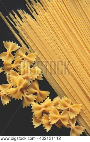 Raw Spaghetti And Farfalle Isolated On Black Background. Pasta. Selective Focus