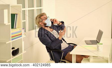 Social Distancing. Man Freelancer Working Online. Guy Wear Mask While Surfing Internet. Limit Spread