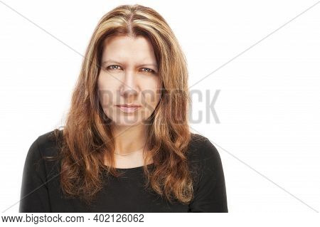 Portrait Of A Middle-aged Woman On A White Background. She Has A Serious Focused Face. She Is Sad. S