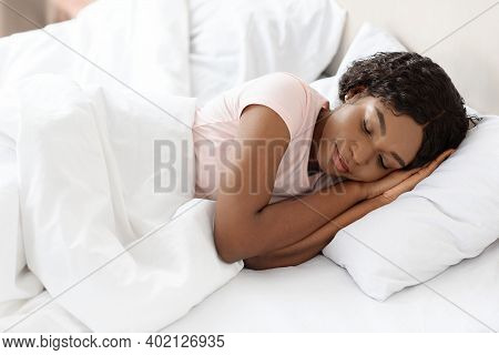 Healthy Sleeping, Sleep Hygiene Concept. Peaceful Young Black Woman Sleeping In Her Bed At Home, Cop