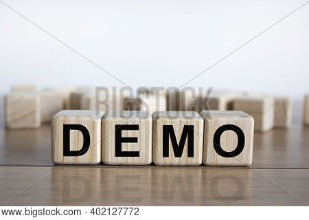 Demo Symbol. Concept Word 'demo' On Cubes On A Beautiful Wooden Table. White Background. Business An
